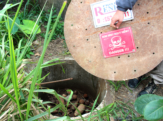 The TBM is a concrete-reinforced and partially buried container with a ventilated lockable lid that is used by scrap dealers to safely quarantine UXO away from children and neighbours.