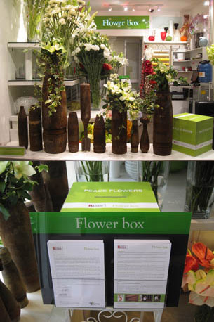 1. Showcase of Peace Flowers. 2. Donation box and leaflet providing UXO information in Vietnam.