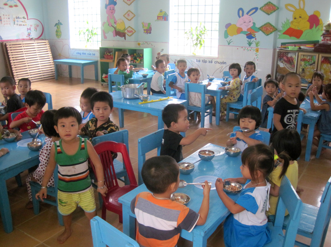 Enjoying lunch in their dining room, these toddlers never knew that a deadly threat had just been removed from their kindergarten grounds.