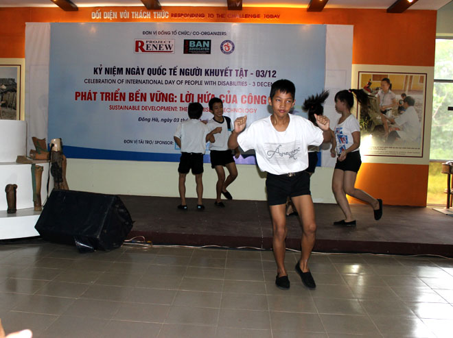 A group of hearing-impaired and visual-impaired kids performing a hip hop dance at the commemoration.