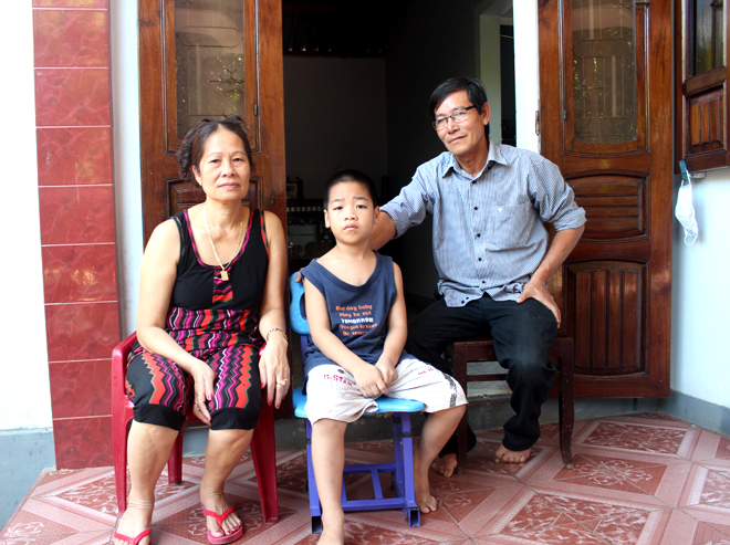 """From now on we feel very safe, after living in fear of UXO for a long time,"" said Mr. Nguyen Van Binh, 60-year-old father of five children, pictured above with his wife and visiting grandson Bin from Hue City. ""Our family is grateful to Project RENEW's team for their prompt intervention to make our garden safe for our daughter's wedding party this weekend."""